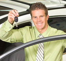 Man standing outside of the car holding car keys