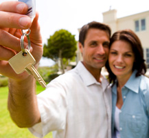 Man and woman holding keys