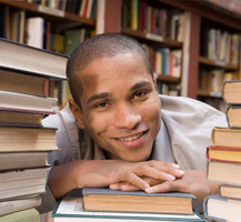 Young man in library with books