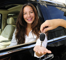 Woman being handed keys to car